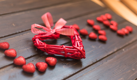 heart shaped stuff: Word Love from the hearts on a wooden background