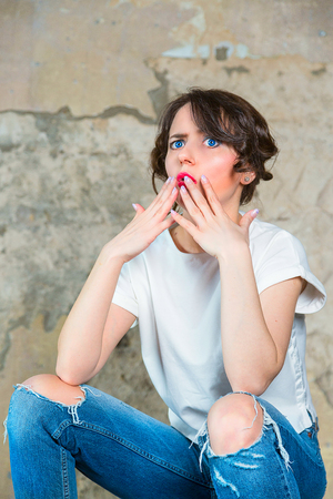 Girl looks indignantly. Concept Surprised woman Stock Photo