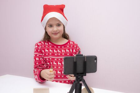 little girl blogger, influence, in a Christmas hat