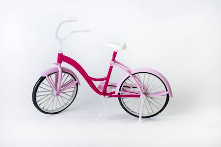 pink bicycle with basket on a white background