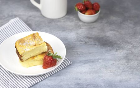 cottage cheese casserole with strawberries on a white plate