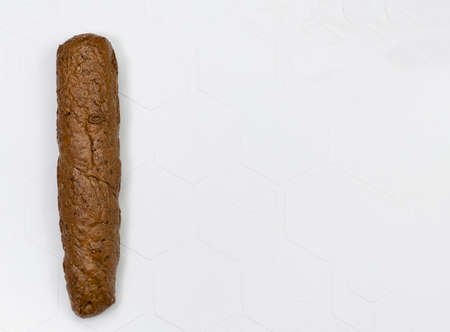 Long french baguette made from white flour, cools after baking isolated on white background.