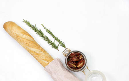 baguette dried tomatoes with fresh rosemary on white texture background Stock fotó