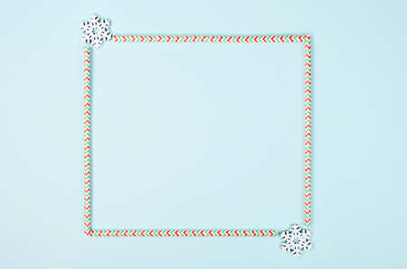 Creative frame of Christmas on pastel blue background. Christmas, winter, new year concept. Flat lay, top view, copy space. Archivio Fotografico