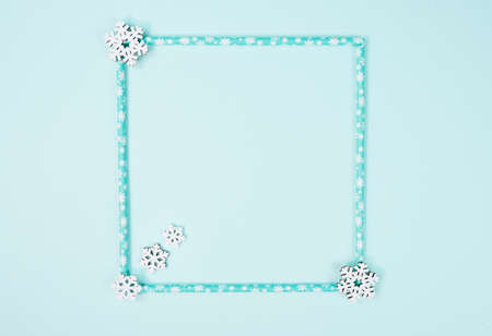 Creative frame of Christmas on pastel blue background. Christmas, winter, new year concept. Flat lay, top view, copy space.