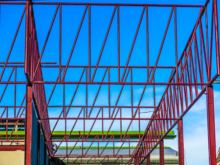 construction project frame roof steel red blue sky