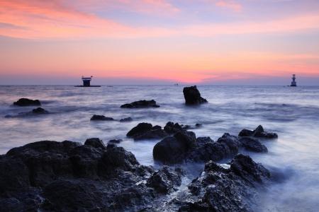 beautiful sun rise over the rocky coast