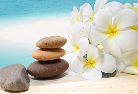 Zen spa concept background  Zen massage stones with frangipani plumeria flower