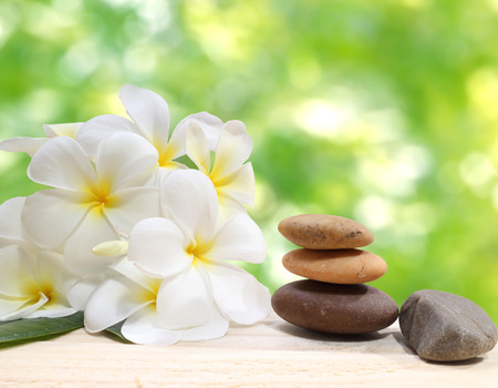 zen: Zen spa concept background  Zen massage stones with frangipani plumeria flower
