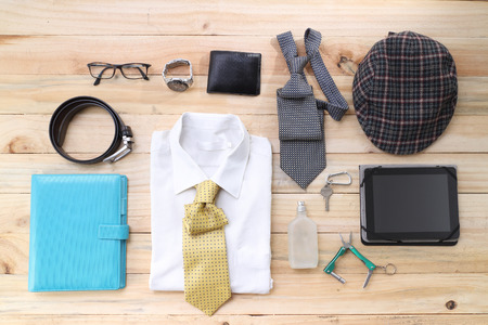 Overhead of essentials modern man. Outfit of business man on wood background Stockfoto