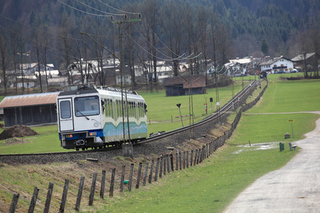 Suburban electric train on way at out of town  background