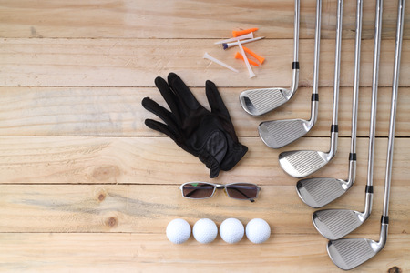 Golf equipment on wood floor preparing for good game Imagens - 41258630