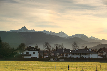 adolf: Panoramic view of beautiful mountain landscape in the Bavarian Alps with village of Berchtesgaden and Watzmann massif in the background at sunrise, Nationalpark Berchtesgadener Land, Bavaria, Germany