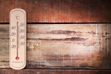 hotter: summer temperature on wood table Stock Photo