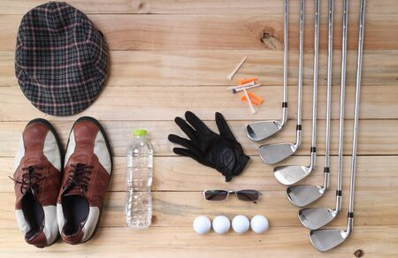 Golf equipment on wood floor preparing for good game