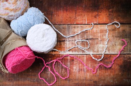 room for copy: Colorful yarn balls on a wooden background room for copy space  vintage style