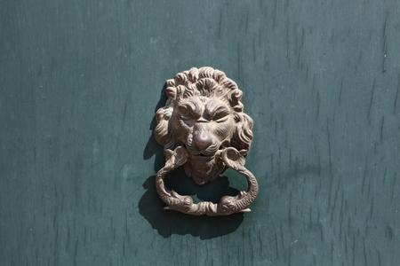 door knocker: Door knocker in the shape of a lion on old wood door Stock Photo