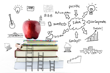 Apple and book with drawing success strategy plan idea..Success Concept. photo