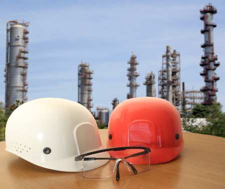 work area: safety helmet on civil engineer working table and work area background