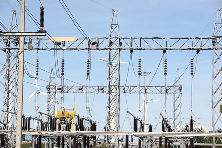 voltage gray: blue sky over an electrical substation.