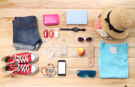 object: Outfit of traveler, student, teenager, young woman or guy. Overhead of essentials for modern young person. Different objects on wooden background.