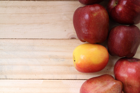 Sweet apples on wooden background photo