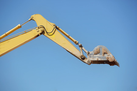 earth moving: excavator in action  on site