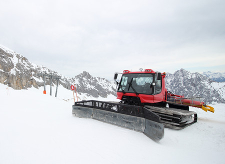 snow grooming machine: Machines for skiing slope preparations at mountain Zugspitze in Germany Europe- nature and sport background