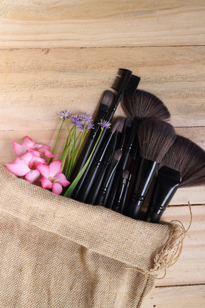loose skin: Various makeup products on wood background with copyspace