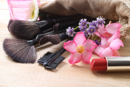 loose skin: Various makeup products on dark background with copyspace Stock Photo