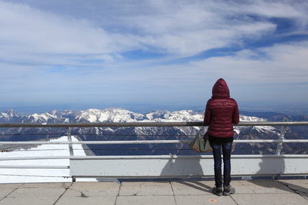 snow covered mountain: Winter snow covered mountain Zugspitze in Germany Europe. woman  standing and happy at moment time