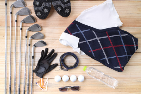 Golf equipment on wood floor preparing for good game photo