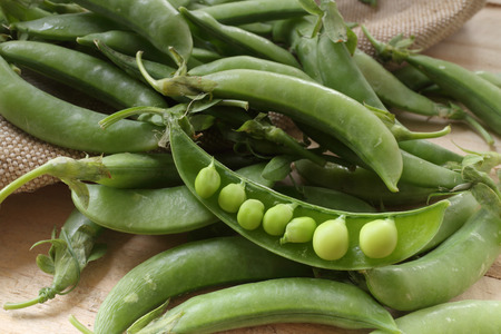 broad: fresh beans broad over wood background, selective focus