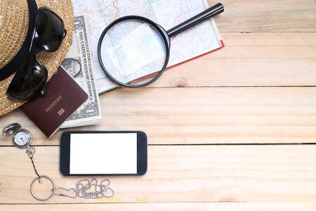 preparation: travel concept,  Preparation for travel,  money, passport, road map on wooden table Stock Photo