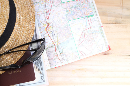 travel map: travel concept,  Preparation for travel,  money, passport, road map on wooden table Stock Photo