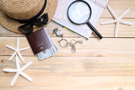 travel concept,  Preparation for travel,  money, passport, road map on wooden table Stockfoto