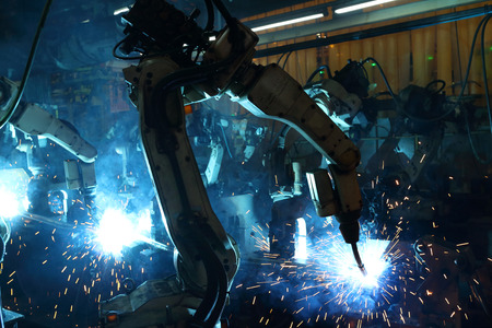 group welding robots are working In the automotive parts industry.