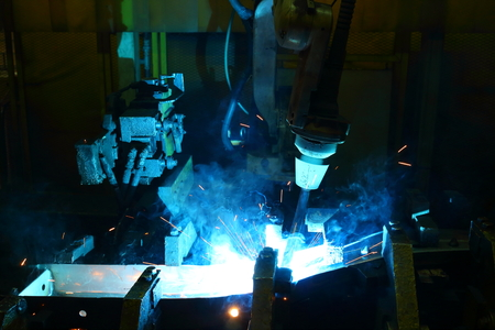 car factory: Team welding robots represent the movement. In the automotive parts industry. Stock Photo