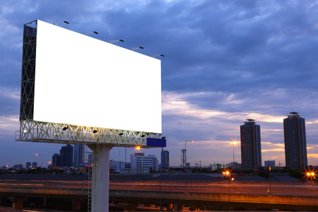Blank billboard for advertisement at twilight Фото со стока