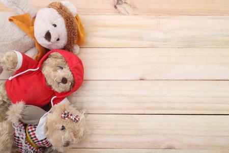 teddy: three Cute teddy bear on wood background