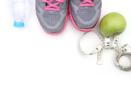 sports activities: Sport shoes and water with set for sports activities on white with copy space Stock Photo