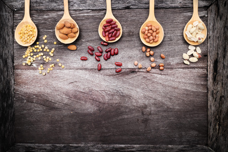 background cover: Natural raw nuts food mix on wooden background