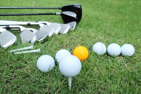 caddie: Golf ball and golf club in bag on green grass Stock Photo