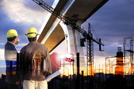 Double exposure of engineering man standing with sunset scene and building construction Silhouette Building background