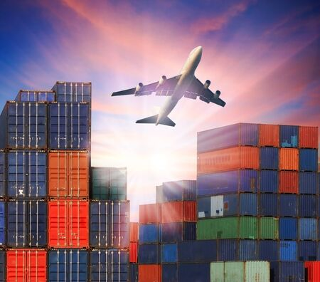 infra construction: industry container  cargo plane flying over ship port use for land ,air and ship transportation in logistic business industry ,import export shipping service