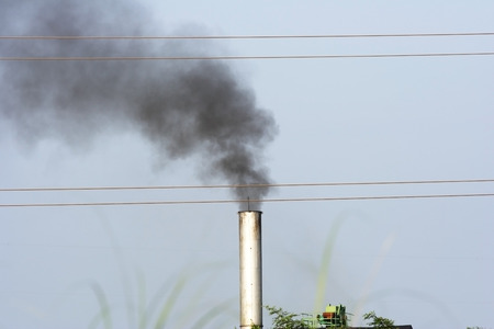 air pollution: black toxic smoke from coal power plant Stock Photo