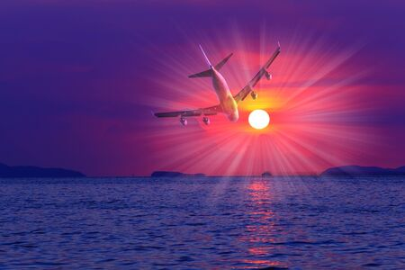 airbus: Airplane in the sky at sunset Stock Photo