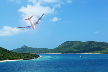 passenger plane flying over beautiful blue ocean and island in purity destination sea beach use for summer holiday vacation traveling 版權商用圖片