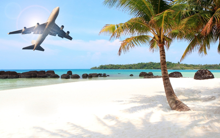 passenger plane flying over beautiful blue ocean and island in purity destination sea beach use for summer holiday vacation traveling Stockfoto