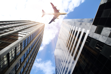 directly below: airplane and Office buildings stretch up to the blue sky in the financial district in downtown Buenos Aires : Argentina